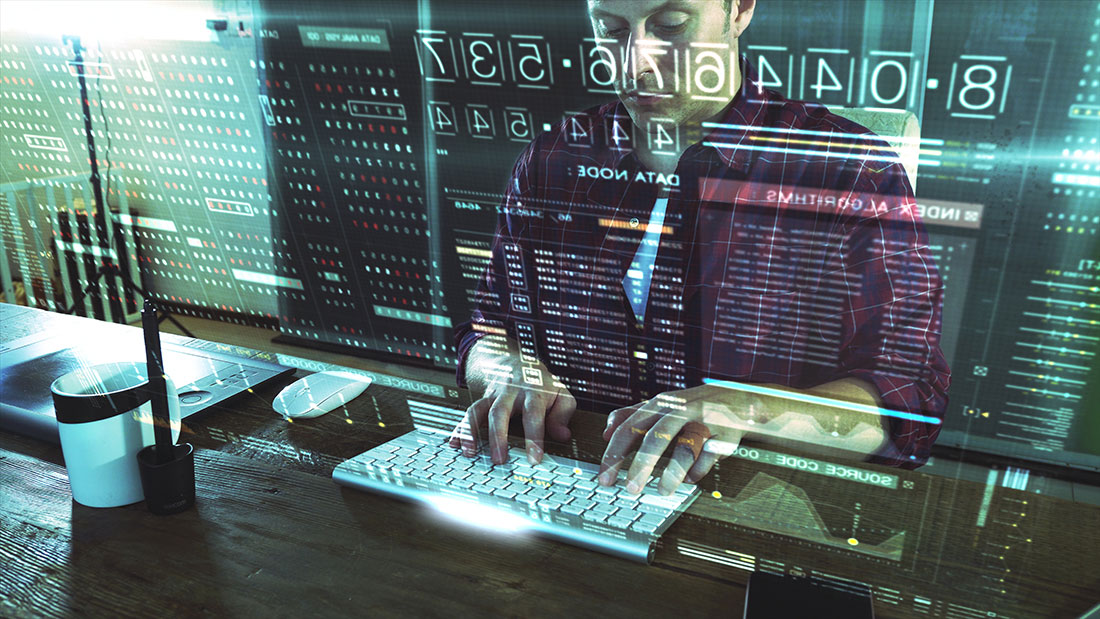 Man programmer attempting to breach computer security by using code